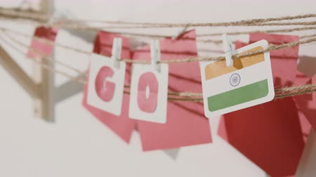 preocupar se : Go word collected by child hand from paper cards with red letters and flag of country India. Travel, motivation, sport, text message, business, language education concept.