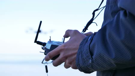 dron : Drone Operator Holding A Transmitter. 4K 3840x2160 Wideo