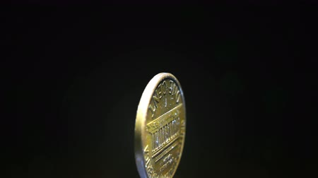 governo : Coin of America one cent turns on black background close up.