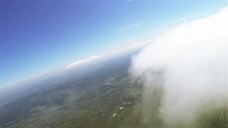 bird list : Real flight in clouds at height of 1800 meters or 5905 ft. Beautiful landscape . Stock Footage