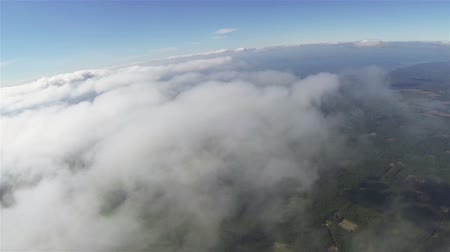 small height : Real flight in clouds at height of 1800 meters or 5905 ft. Beautiful landscape