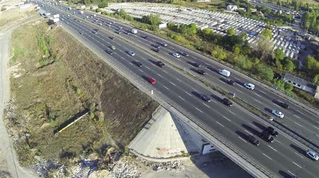 no traffic : Highway with car traffic and bridge. Aerial rear fly Stock Footage