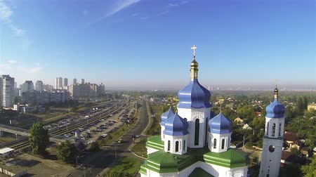 kijev : Up over Orthodox Christian church with blue domes in Kiev, capital of Ukraine. Aerial