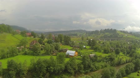 obec : Landscape in small mountains with village. Aerial shot Dostupné videozáznamy