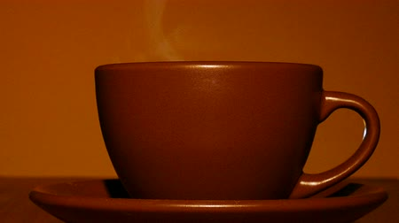 hot beverage : Brown cup of hot coffee or tea with steam close up. 4K shot Stock Footage