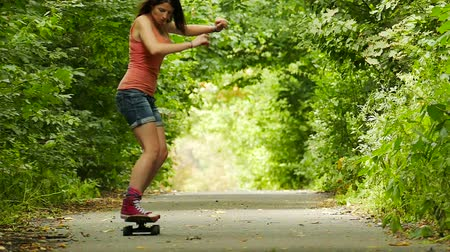 longboarder : Youth culture. Girl with skateboard jump in summer park. Slow motion