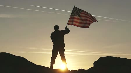 asker : Soldier silhouette and American Flag in Slow Motion. Stok Video