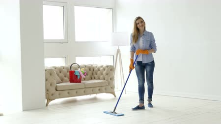 cleaning equipment : Woman model like housewife posing in photo studio, backstage Stock Footage
