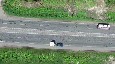 onarılmış : 4K Aerial. Fly over Car With Caravan, trailer On Road. Top view