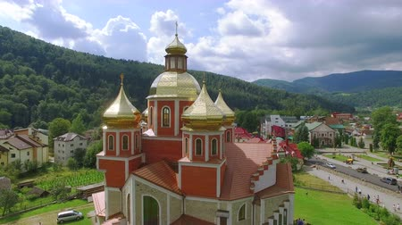 yaldız : 4K .Aerial. Fly over the Orthodox Church with gilded domes in small city