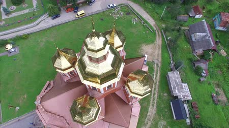 yaldız : 4K .Aerial. Fly around the Orthodox Church with gilded domes in small city Stok Video