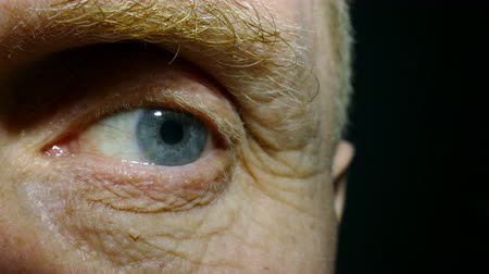 rectus : An eye of old man with red capillaries. Stock Footage