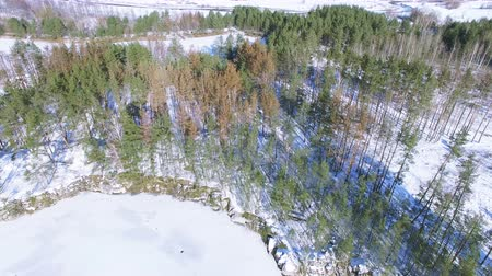 aeroespaço : 4K Aerial. Winter frozen lake with snow covered surface Vídeos