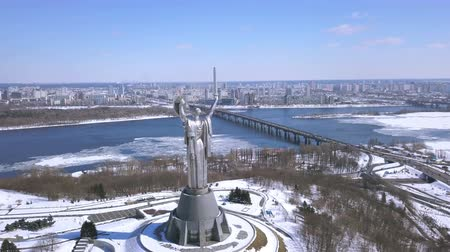 motherland : 4K. Kyiv city - capital of Ukraine.MotherMotherland Soviet time monument. Aerial winter shot Stock Footage