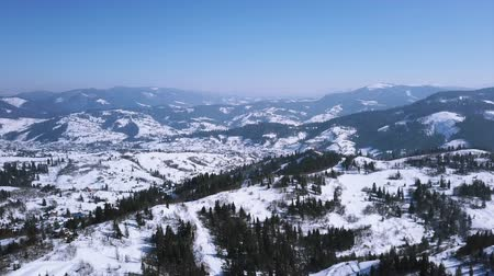 Aerial.Winter time in mountains hills.Flight with decrease Стоковые видеозаписи