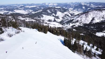 4k.Aerial.Skiers silhouettes and mountains rest.Winter ski rest time