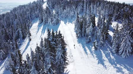 4k.Aerial.One skier silhouette snow pond with snow.Top view