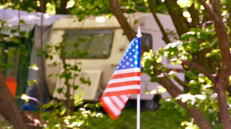 Caravan, trailer with American flag in wood. Slow motion slider Стоковые видеозаписи