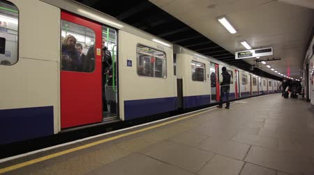 mind the gap : Electric subway train coming and moving from the Tower Hill underground station of the London and stops at a platform and passengers embark and disembark, April 3, 2013 in London, UK.