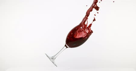 şarap cam : Glass of Red Wine Breaking and Splashing against White Background, Slow motion 4K Stok Video