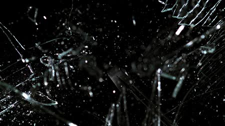 shattering : Hammer broking pane of glass, slow motion