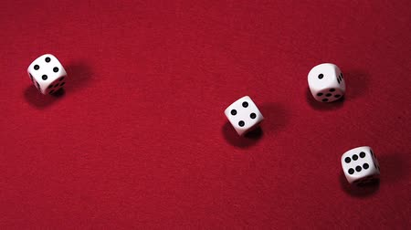 risco : Dice rolling against Red background, slow motion