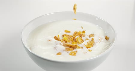 falling : Cereals falling into a Milk Bowl, Slow Motion 4K Stock Footage