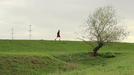 A man jogging outdoors. Can be Used as a looping image too.