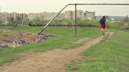 A man jogging outdoors in the suburb area. Стоковые видеозаписи