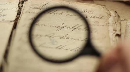 Close up of vintage book and magnifying glass.