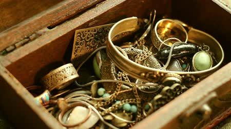 wedding and gold : Searching in a Jewelry Box Stock Footage