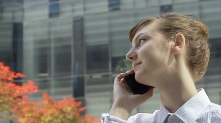 Energetic Woman Talking by Phone