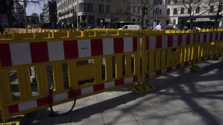roadworks : Hannover, Germany, April 17 2018: Roadworks In Hanover city center. Part of road near to Central Railway Station of road is fence off. Construction work to repair road surface. 4K on Sony a6300 Stock Footage
