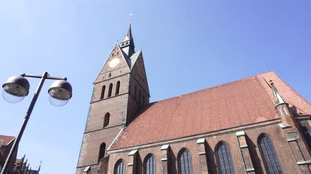 lutheran : Market Church of Sts. George and James, Hannover, Germany, April 17 2018: Old Town Market Lutheran Church or Marktkirche, roof building facade outdoor view. Warm sunny spring day.