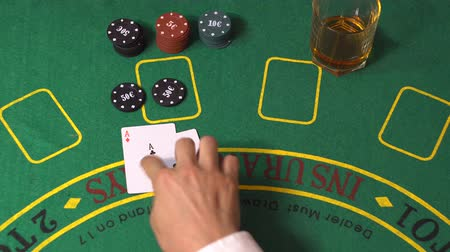 blackjack : Blackjack gambling game. Female player bet chips. Dealer put cards on green deck table. Gambler deal two aces, split them, get 10 on each. Woman win. Background concept of winner casino, top view 4K Stock Footage