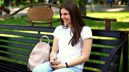 Young woman laughing at summer park Dostupné videozáznamy