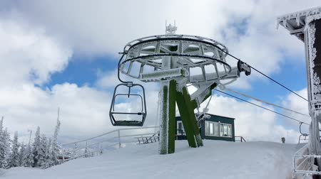 chairlift : Ski chair lift station on mountain top in a sunny winter day