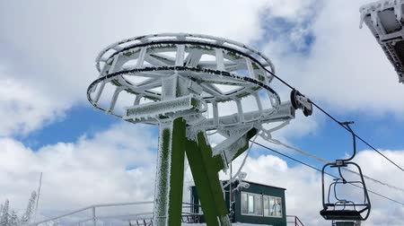 chair lift : Ski chair lift station on mountain top in a sunny winter day