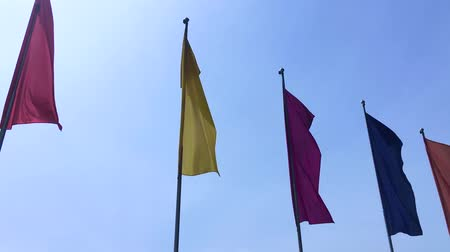 торжества : Colorful flags blowing on the wind on blue sky background