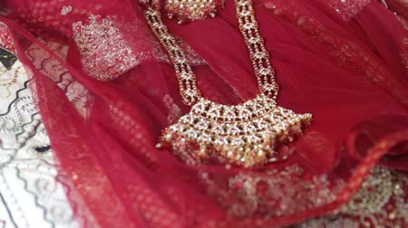 brocade : indian jewelry lays on indian cloths