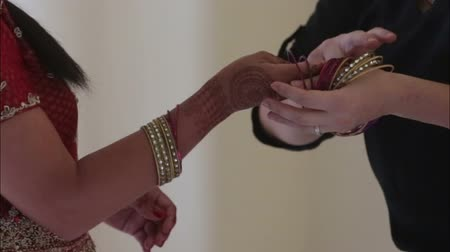 asian and indian ethnicities : indian woman dress on bracelet