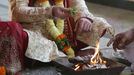 indian ethnicity : widding ceremony fire food Stock Footage