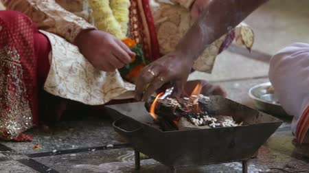 indian ethnicity : widding ceremony fire oil