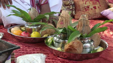 traditional ceremony : Facilities are on the bedspread on the Indian wedding ceremony coconuts fruit rice Brahmin