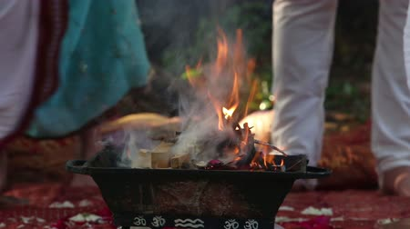 traditional ceremony : bride and groom and brahman stand near the sacred fire on the Indian wedding ceremony