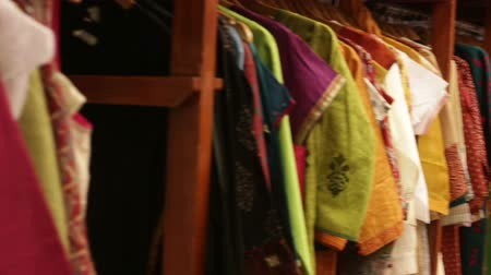 roupas : clothes hanging and lying on the shelves in the store Stock Footage