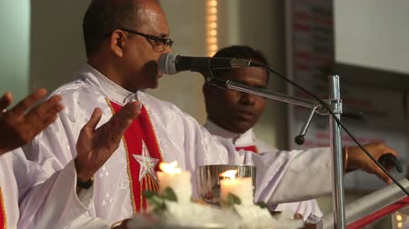 catholic cathedral : PARVORIM, GOAINDIA - FABRUARY 01 2014:three priests held a wedding ceremony in the Catholic Church in India on Fabruary 1 in Parvorim. Stock Footage
