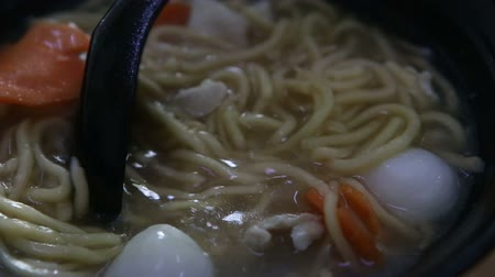 rosół : take with spoon fish balls in chinese black plate noodle soup Wideo