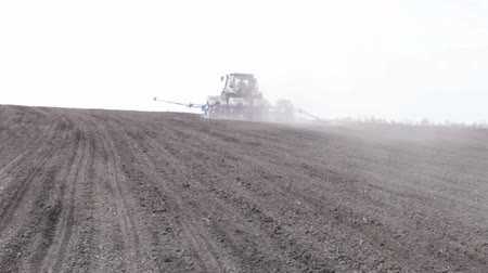 goes : tractor with planter turn and goes to the horizon Stock Footage