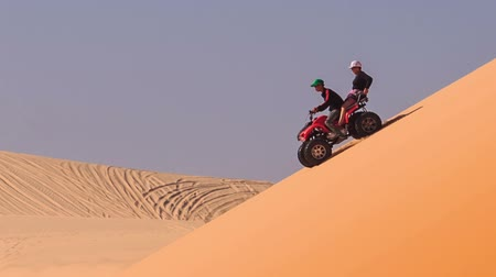 crest dune : MUI NE, BINH THUAN  VIETNAM - MARCH 19 2016: Quad runs down in white sand dunes against sand background and blue sky on March 19 in Mui ne